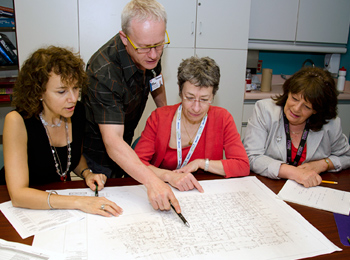 Andréane Pharand, Mario Bonenfant, Dr. Therese Perreault and Lynn Lauzon review the plans of their new unit